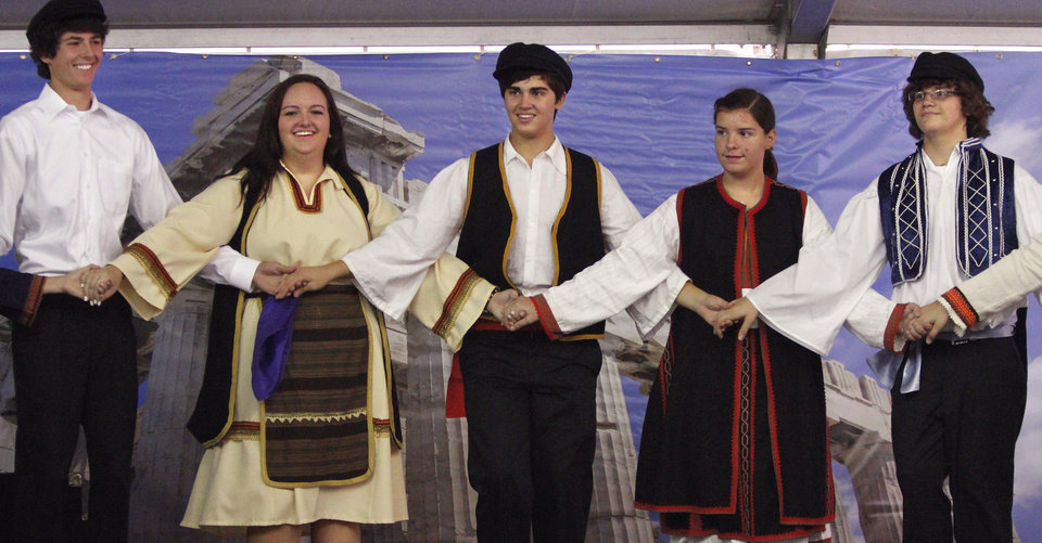 The Agape dancers, a troupe comprised of teens in the sixth grade through senior year of high school, dress in native attire to perform folk dances of Greece. Members of St. George\'s Greek Orthodox Church and community volunteers are sponsoring this years Greek Festival of Oklahoma City. The festival includes food, dancing and an introduction to Greek culture at the church, NW 145 and N. Pennsylvania on Saturday, Sep. 15, 2012, Photo by Jim Beckel, The Oklahoman.