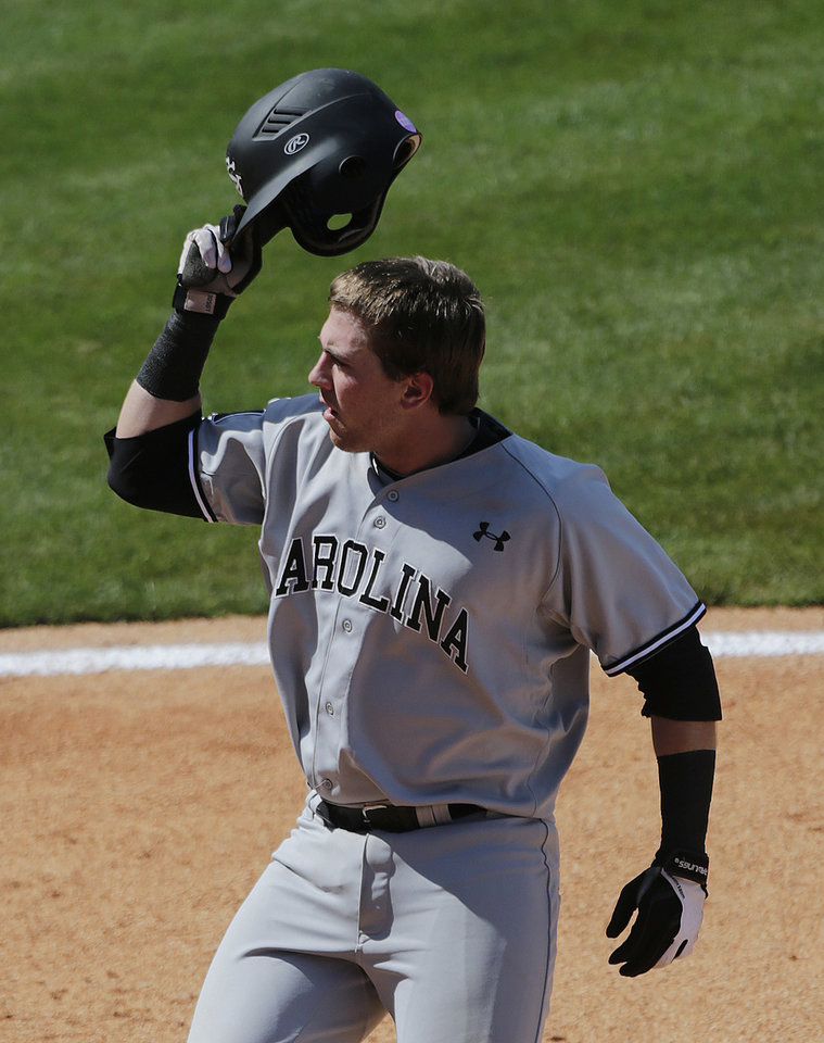 Photo - South Carolina's LB Dantzler tips his helmet after hitting a solo home run off Vanderbilt's Carson Fulmer in the seventh inning of their Southeastern Conference Tournament college baseball game at the Hoover Met in Hoover, Ala., Thursday, May 23, 2013. (AP Photo/Dave Martin)