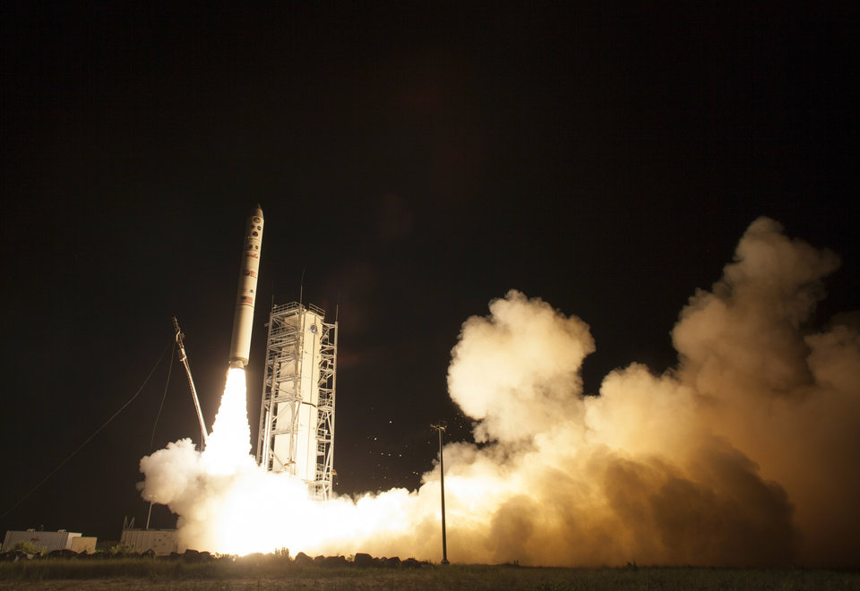 Photo - In this photo provided by NASA, an unmanned Minotaur rocket carries NASA's newest robotic explorer, the LADEE spacecraft, which is charged with studying the lunar atmosphere and dust, after launching to the moon from NASA's Wallops Flight Facility on Virginia's Eastern Shore on Friday, Sept. 6, 2013. (AP Photo/NASA, Carla Cioffi)