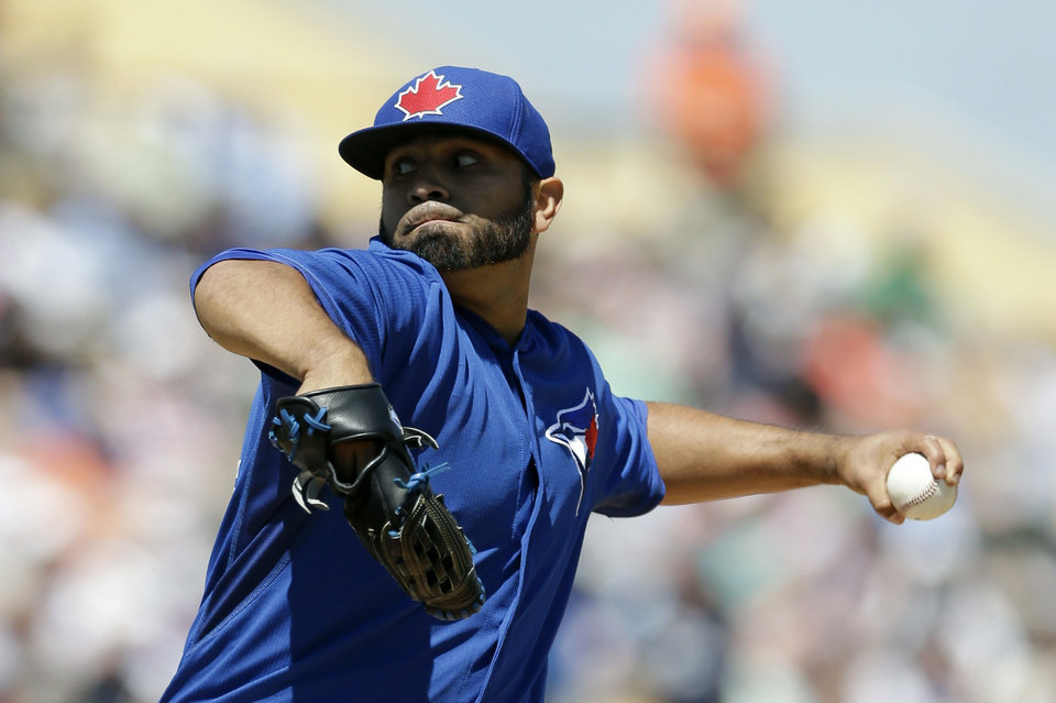 Photo - Toronto Blue Jays starting pitcher Ricky Romero throws during the first inning of a spring exhibition baseball game against the Detroit Tigers in Lakeland, Fla., Tuesday, March 18, 2014. (AP Photo/Carlos Osorio)