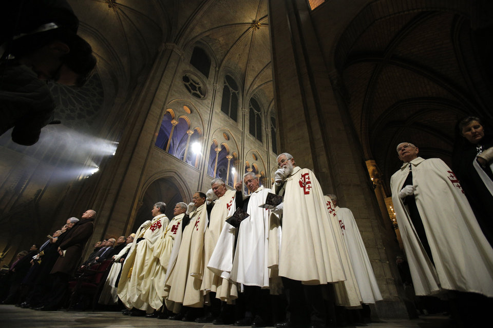 Religious dignitaries attend a ceremony at Paris' Notre Dame Cathedral for its 850th anniversary , Wednesday, Dec. 12, 2012. Paris' Notre Dame Cathedral is kicking off its 850th anniversary celebrations, which will include new bells for the medieval landmark, cast in a foundry in Normandy. (AP Photo/Christophe Ena) ORG XMIT: ENA108