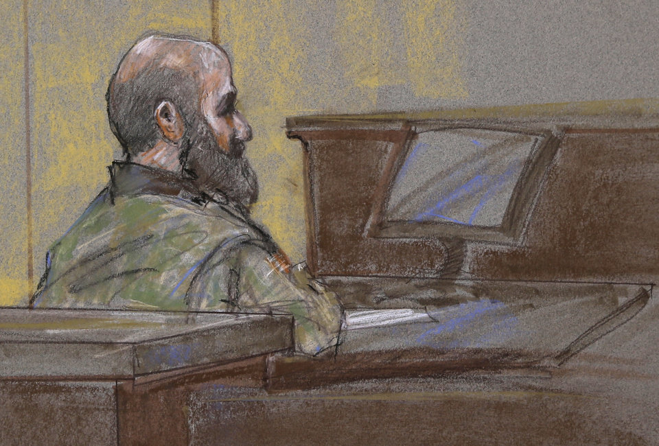 Photo - File - In this Aug. 23, 2013 file courtroom sketch, U.S. Army Maj. Nidal Malik Hasan is shown as the guilty verdict is read at his court martial, in Fort Hood, Texas. A military jury has sentenced Hasan to death for the 2009 shooting rampage at Fort Hood that killed 13 people and wounded more than 30 others. (AP Photo/Brigitte Woosley, File)
