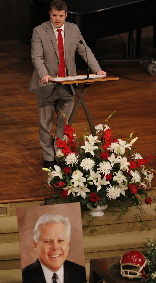 Photo - Steve Davis' son Bo speaks of his father during the funeral for former University of Oklahoma football player Steve Davis at the First Baptist Church on Monday, March 25, 2013, in Tulsa, Okla. Davis died in a plane crash last week in Indiana. Photo by Chris Landsberger, The Oklahoman