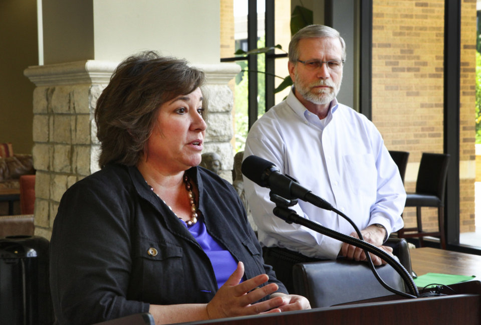 Photo - Principal investigator Carrie Ciro, Ph. D. and Alzheimer's patient Ron Grant at press conference at OU College of Allied Health about a new Alzheimer's study Tuesday.  David McDaniel - The Oklahoman