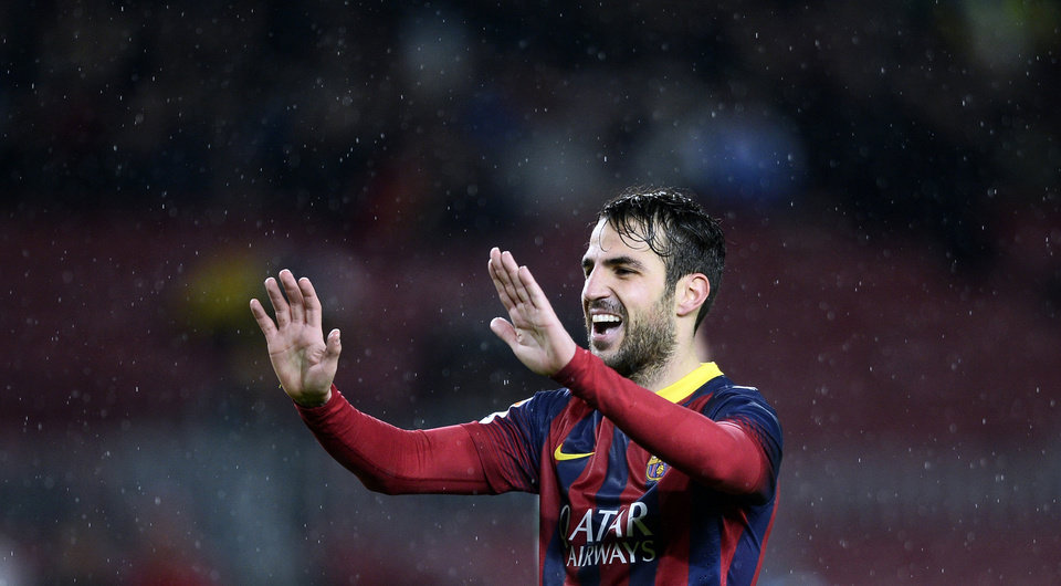 Photo - CORRECTS THE NAME OF BARCELONA'S OPPONENTS  FC Barcelona's Cesc Fabregas reacts after scoring against Levante during a Copa del Rey soccer match at the Camp Nou stadium in Barcelona, Spain, Wednesday, Jan. 29, 2014. (AP Photo/Manu Fernandez)