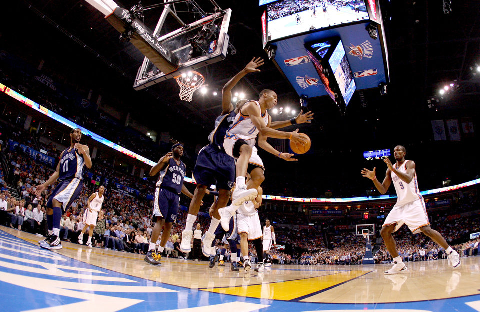 Oklahoma CIty\'s Russell Westbrook passes the ball in front of Hasheem Thabeet of Memphis to Serge Ibaka during the NBA basketball game between the Oklahoma City Thunder and the Memphis Grizzlies at the Ford Center in Oklahoma City on Wednesday, April 14, 2010. Photo by Bryan Terry, The Oklahoman ORG XMIT: KOD