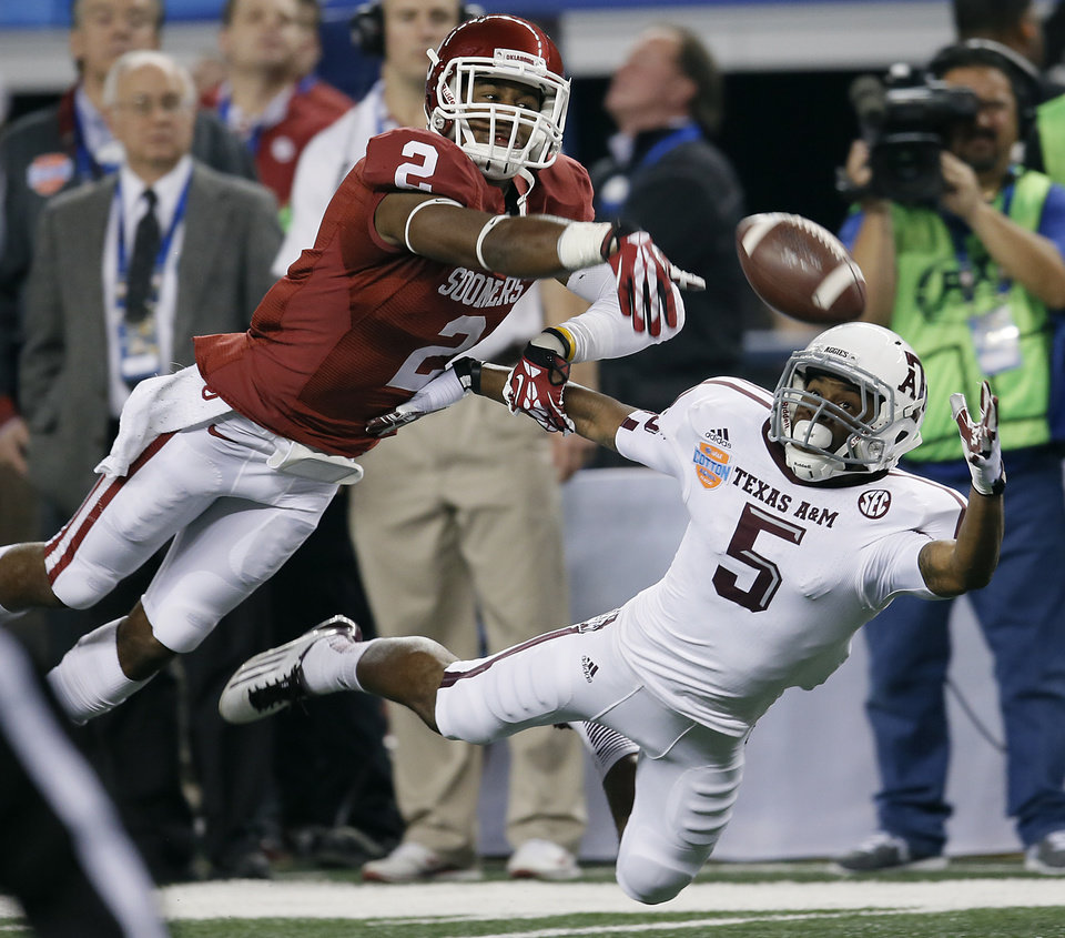 Oklahoma\'s Julian Wilson (2) breaks up a pass for Texas A&M\'s Kenric McNeal (5) during the college football Cotton Bowl game between the University of Oklahoma Sooners (OU) and Texas A&M University Aggies (TXAM) at Cowboys Stadium on Friday Jan. 4, 2013, in Arlington, Texas. Photo by Chris Landsberger, The Oklahoman