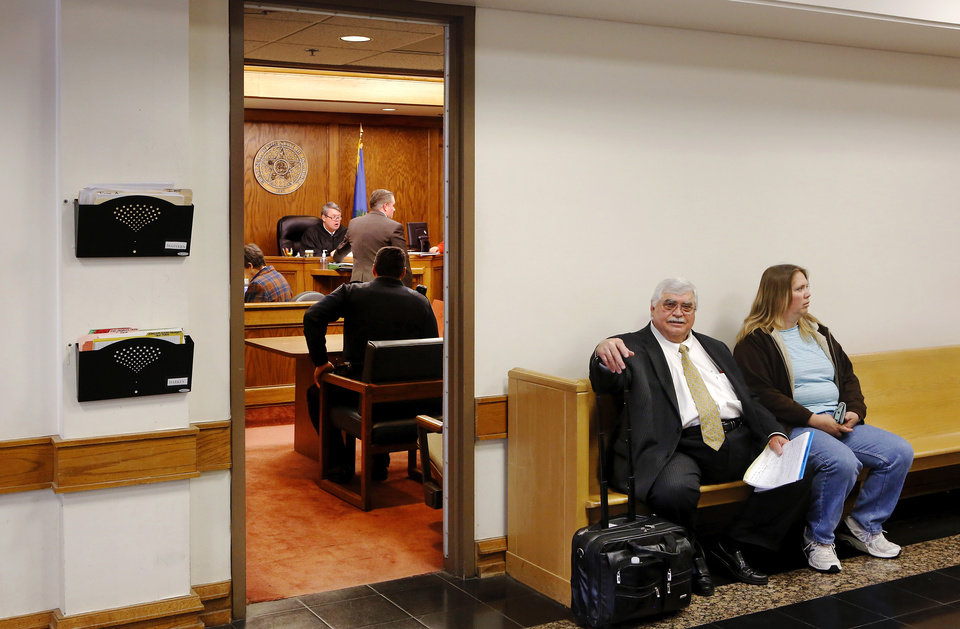 An attorney and client wait outside the courtroom of Michael McGivern, a workers comp judge, at  Workers Compensation Court in the Denver Davison Building near the state Capitol on Thursday,  Feb. 21, 2013.   Photo by Jim Beckel, The Oklahoman