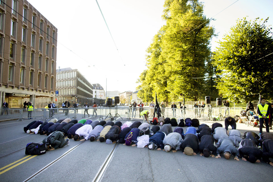 "Muslim demonstrators pray near the US Embassy, 2nd building from left, in Oslo Friday Sept. 21, 2012, during a protest against the video ""Innocence of Muslims"". Some 70 people took part in the hour-long demonstration on Friday afternoon. Police blocked off the street during the peaceful protest. AP photo"
