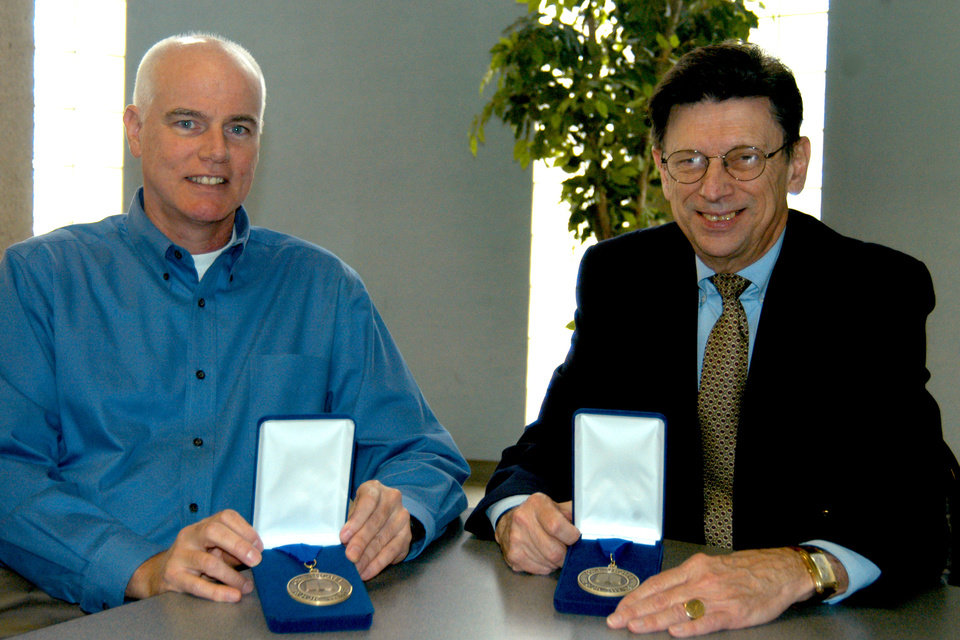 Rose State College Authors Tim Tharp (left) and Carl Sennhenn (right) pose with their medals. They are recipients of the 2006 Oklahoma Center for the Book Awards<br/><b>Community Photo By:</b> Steve Reeves<br/><b>Submitted By:</b> Donna, Choctaw
