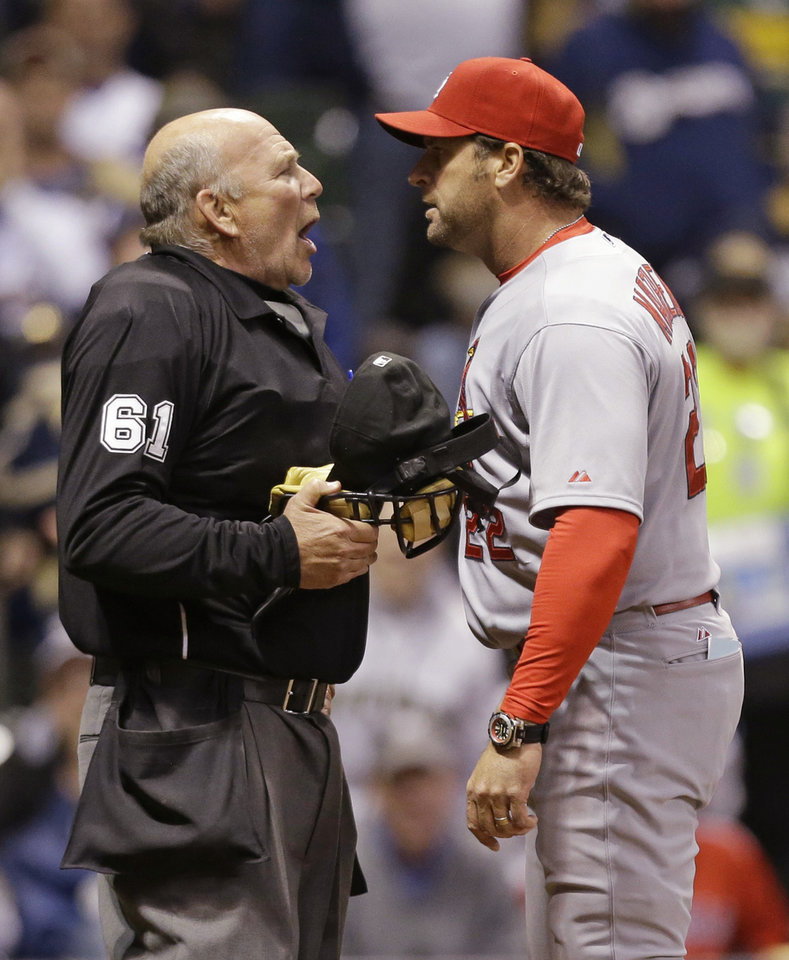 Photo - St. Louis Cardinals Manager Mike Matheny, right, argues a call with home plate umpire Bob Davidson during the fifth inning of the MLB National League baseball game against the Milwaukee Brewers Monday, April 14, 2014, in Milwaukee. (AP Photo/Jeffrey Phelps)