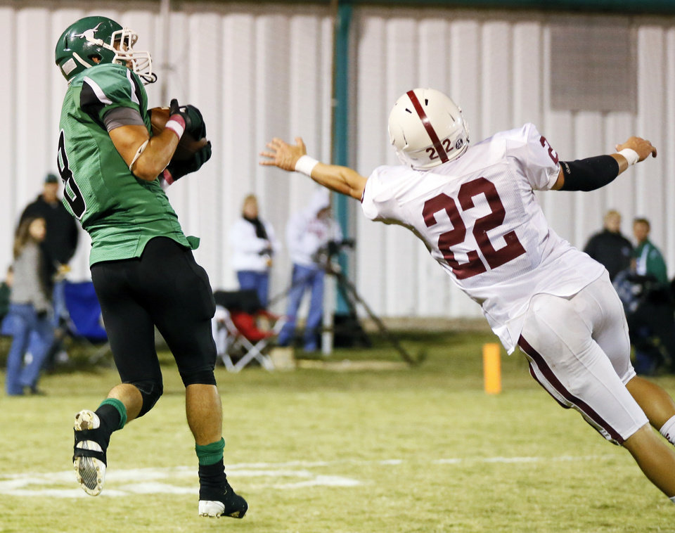 Levi Fox (8) of Jones makes a touchdown catch past Tuttle's Deakon Mincey (22) during a high school football game between Jones and Tuttle in Jones, Okla., Friday, Oct. 25, 2013. Photo by Nate Billings, The Oklahoman