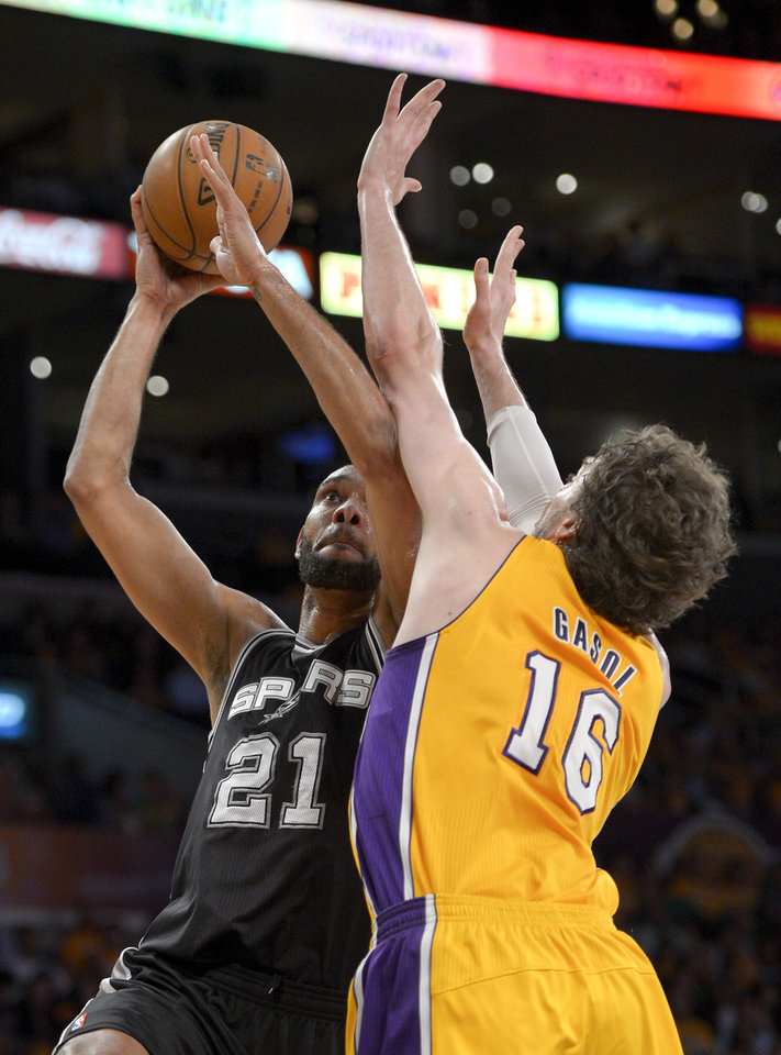 San Antonio Spurs forward Tim Duncan, left, shoots over Los Angeles Lakers forward Pau Gasol, of Spain, during the first half in Game 3 of a first-round NBA basketball playoff series on Friday, April 26, 2013, in Los Angeles. (AP Photo/Mark J. Terrill)