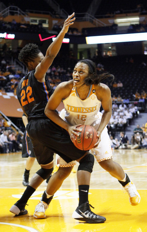 Photo - Tennessee forward Bashaara Graves (12) works for a shot against Florida guard Kayla Lewis (22) in the first half of an NCAA college basketball game Thursday, Jan. 23, 2014, in Knoxville, Tenn. (AP Photo/Wade Payne)