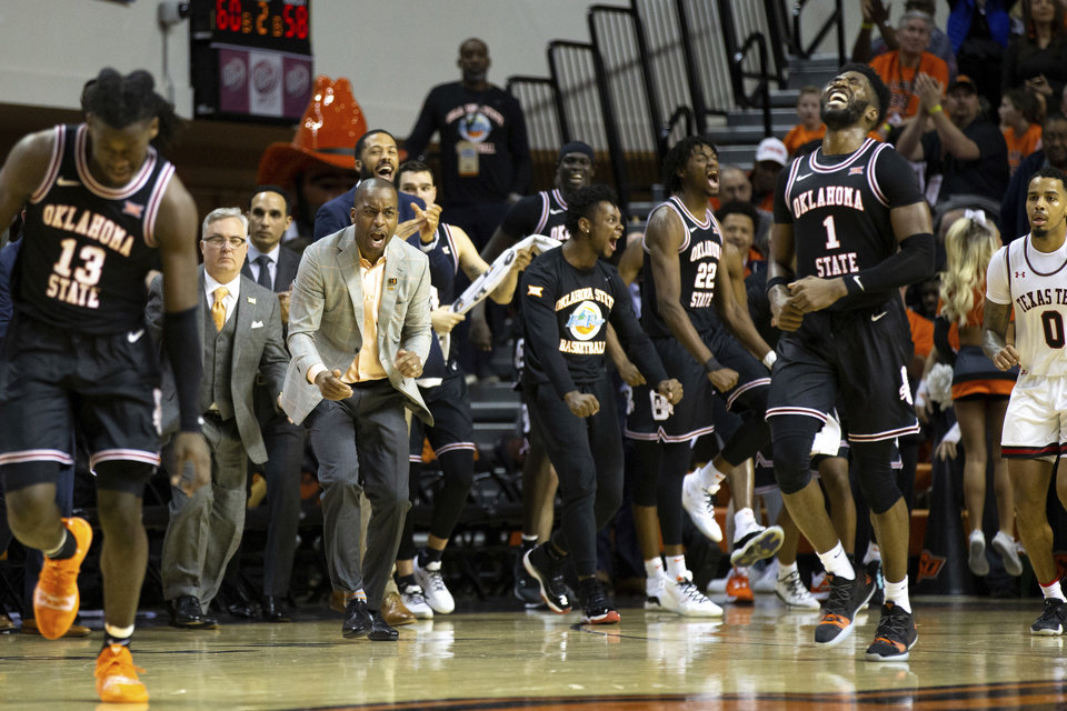 Photo - Oklahoma State head coach Mike Boynton Jr. and team celebrate during the second half of Oklahoma State's 73-70 victory over Texas Tech in the NCAA college basketball game in Stillwater, Okla., Saturday, February 15, 2020. (AP Photo/Mitch Alcala)
