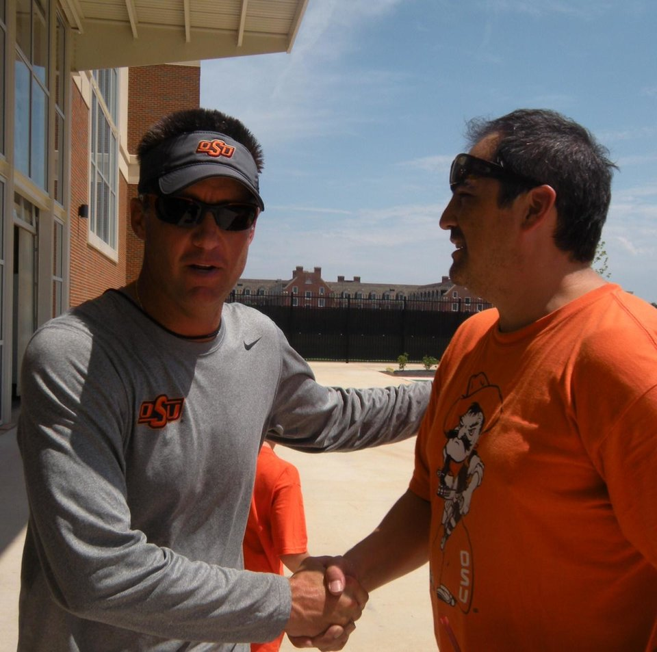 Photo - Mike Gundy with Larry Mahetsky. PHOTO PROVIDED