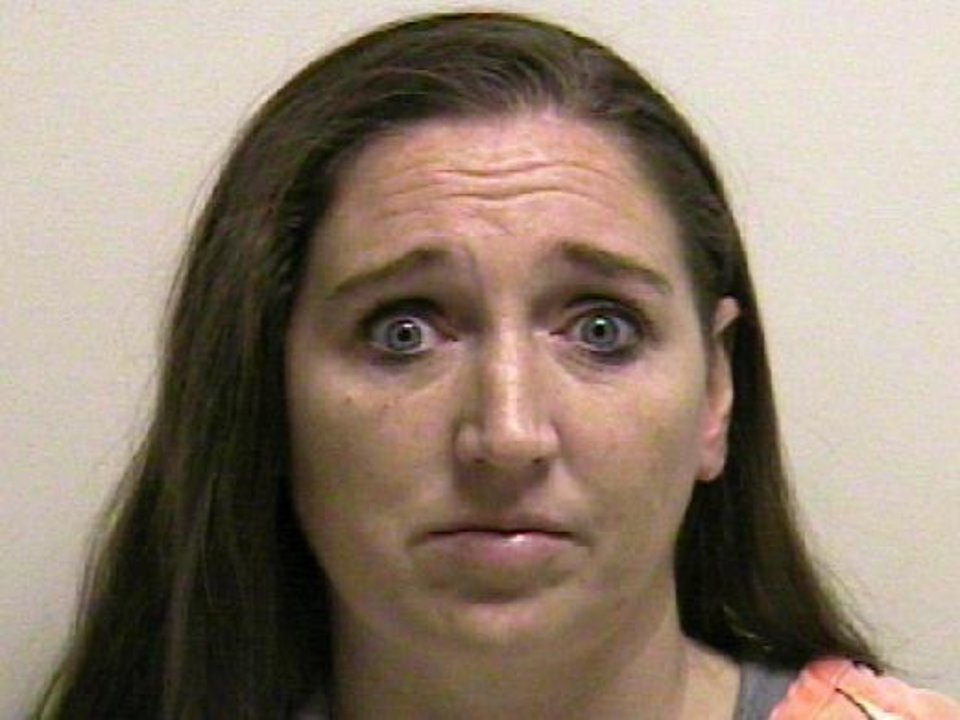 Photo - This photo provided by the Utah County jail shows Megan Huntsman, who was booked into the Utah County jail on suspicion of killing six of her newborn children over the past decade. Seven dead babies were found in a garage at a Pleasant Grove home where Huntsman lived up until 2011. (AP Photo/Utah County Jail) Courtesy Utah County Jail