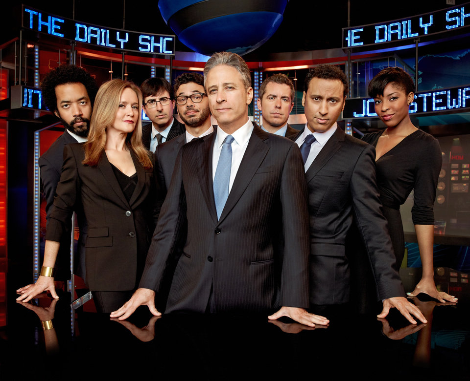 Photo -   This undated image released by Comedy Central shows, from left, Wyatt Cenac, Samantha Bee, John Oliver, Al Madrigal, Jon Stewart, Jason Jones, Aasif Mandvi and Jessica Williams from