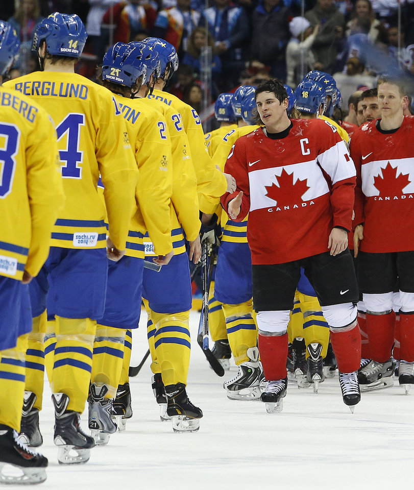 Photo - Canada forward Sidney Crosby greets members of team Sweden after Canada won  the men's gold medal ice hockey game 3-0 at the 2014 Winter Olympics, Sunday, Feb. 23, 2014, in Sochi, Russia. (AP Photo/Matt Slocum)