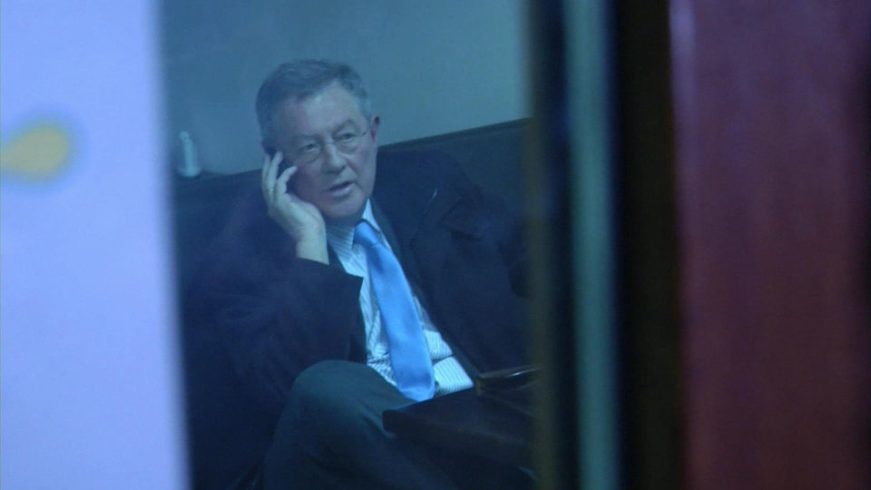 Photo - This image taken from AP video shows Robert Serry sat in a cafe in Simferopol, Ukraine, as he makes a call on his mobile phone, Wednesday, March 5, 2014 as men in famouflage outfits stood outside. The special U.N. envoy who is visiting Crimea was threatened by 10 to 15 armed men on Wednesday and ordered to leave the region, where Ukraine and Russia are locked in a tense standoff, U.N. officials said. Later, an Associated Press reporter found Robert Serry in the business class lounge of the Simferopol airport on Wednesday evening.