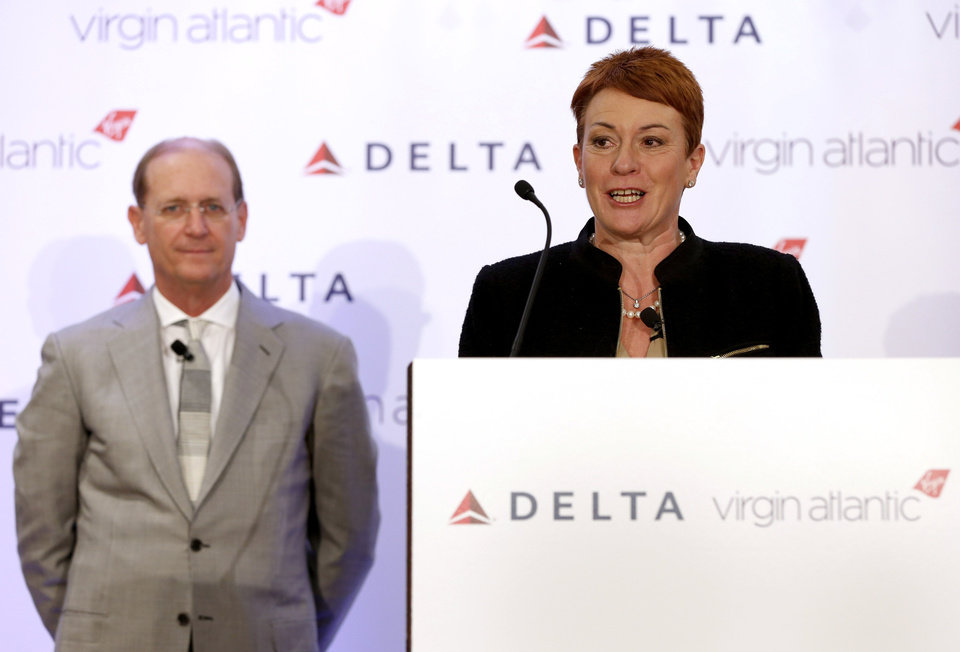Photo - Virgin Atlantic CCO Julie Southern speaks while Delta Airlines CEO Richard Anderson listens during a news conference in New York, Tuesday, Dec. 11, 2012. Delta Air Lines said it will buy almost half of Virgin Atlantic for $360 million as it tries to catch up to rivals in the lucrative New York-to-London travel market. (AP Photo/Seth Wenig)
