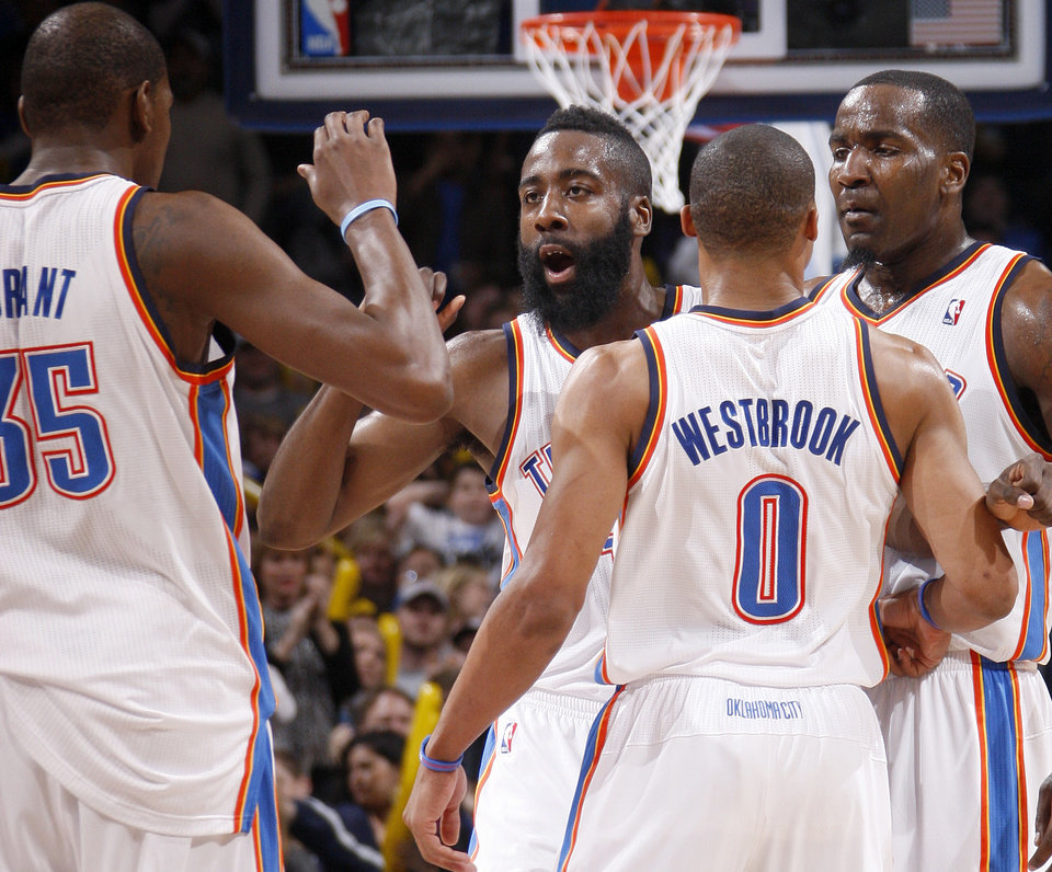 Photo - Oklahoma City's James Harden (13), Kevin Durant (35), Russell Westbrook (0), and Kendrick Perkins (5) celerbate during the NBA game between the Oklahoma City Thunder and the New York Knicks at Chesapeake Energy Arena in Oklahoma CIty, Saturday, Jan. 14, 2012. Photo by Bryan Terry, The Oklahoman