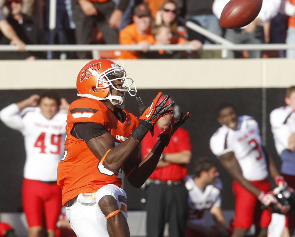 Photo -   Oklahoma State wide receiver Isaiah Anderson catches a pass from quarterback Clint Chelf and takes it in for a touchdown against Texas Tech in the second quarter of an NCAA college football game in Stillwater, Okla., Saturday, Nov. 17, 2012. (AP Photo/Sue Ogrocki)