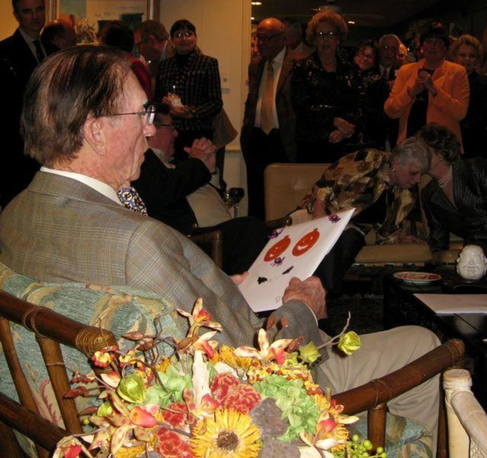 PARTY TO REMEMBER...Dr. Dick Clay celebrates his birthday with cards and photo books. (Photo by Helen Ford Wallace).
