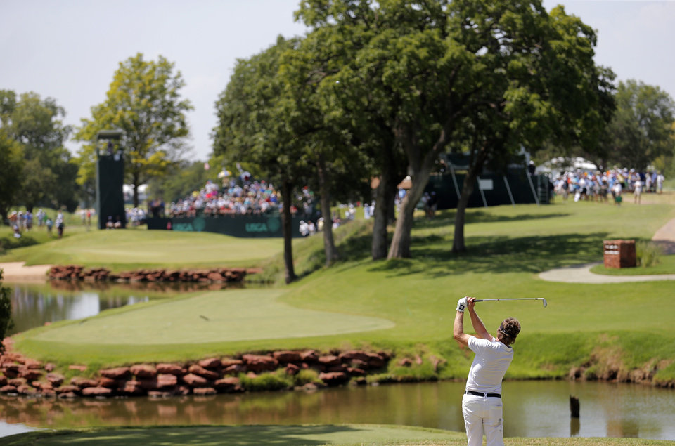 Photo - Bernhard Langer tees off from the 13th hole in the final round of the U.S. Senior Open golf tournament at Oak Tree National in Edmond, Okla., Sunday, July 13, 2014. Photo by Sarah Phipps, The Oklahoman
