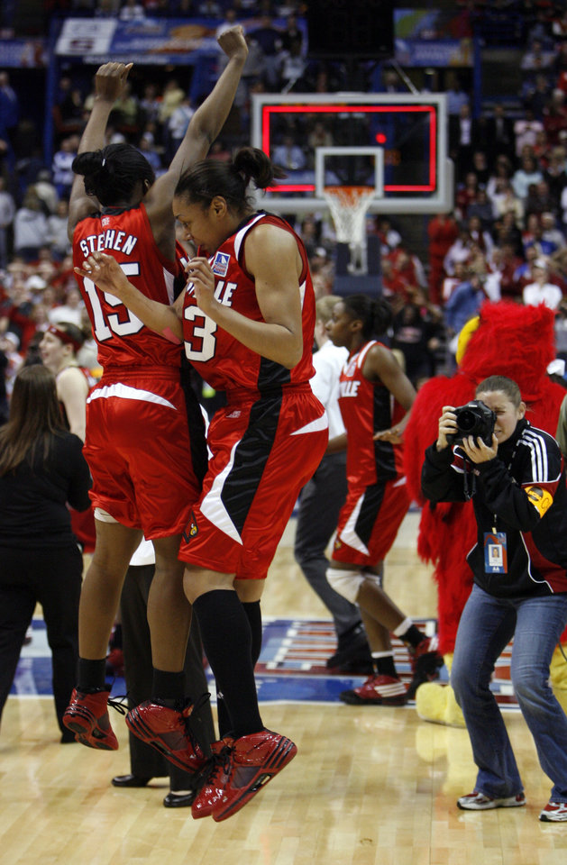 Photo - Louisville players Tiera Stephen (15) and Candyce Bingham (13) celebrate as they defeat the University of Oklahoma 61-59 at the 2009 NCAA women's basketball tournament Final Four in the Scottrade Center in Saint Louis, Missouri on Sunday, April 5, 2009. 