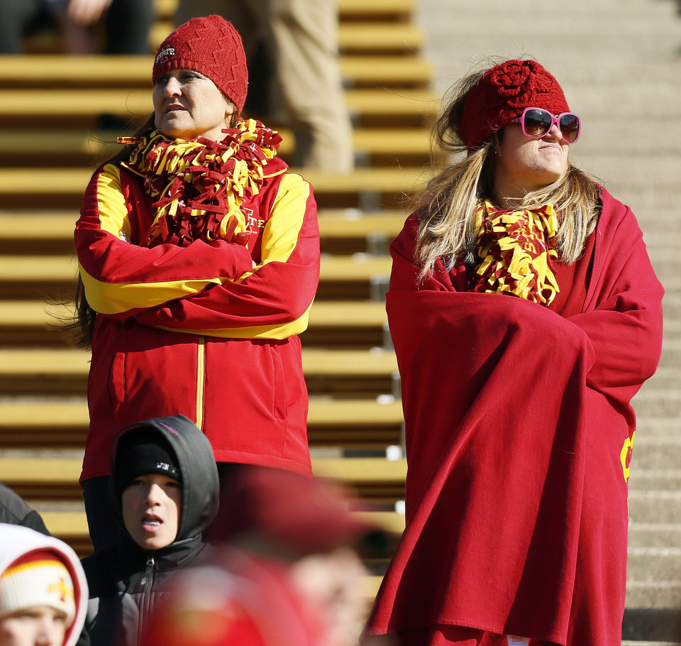 Photo - Iowa State fans stand in the second half during a college football game between the University of Oklahoma Sooners (OU) and the Iowa State Cyclones (ISU) at Jack Trice Stadium in Ames, Iowa, Saturday, Nov. 1, 2014. Photo by Nate Billings, The Oklahoman