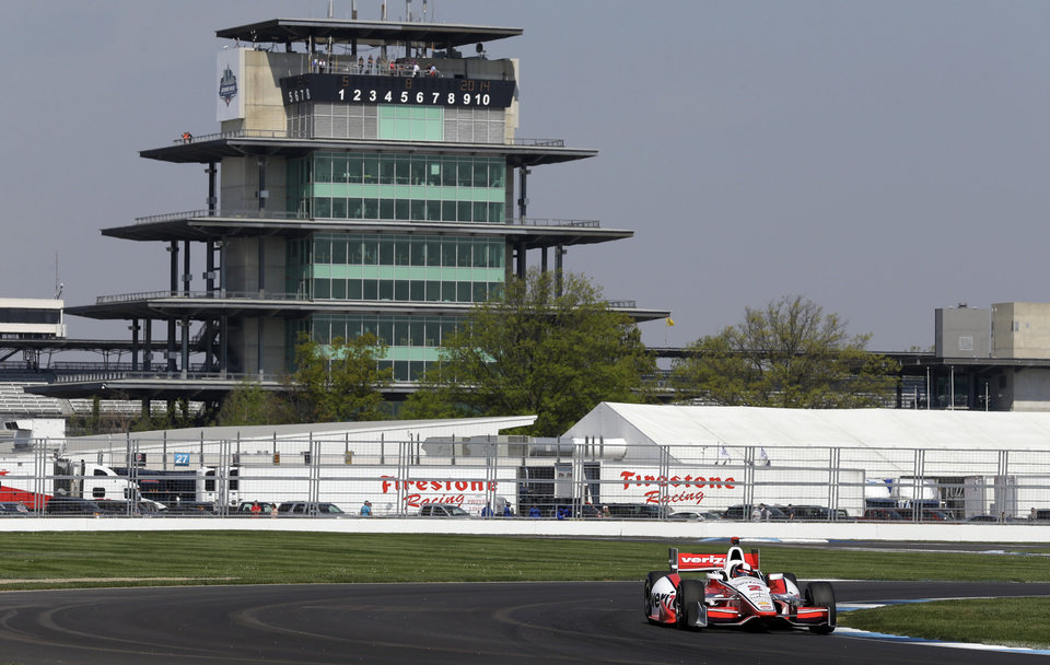 Photo - Juan Pablo Montoya, of Colombia, drives out of turn 7 during practice for the inaugural Grand Prix of Indianapolis IndyCar auto race at the Indianapolis Motor Speedway in Indianapolis, Thursday, May 8, 2014. (AP Photo/Michael Conroy)
