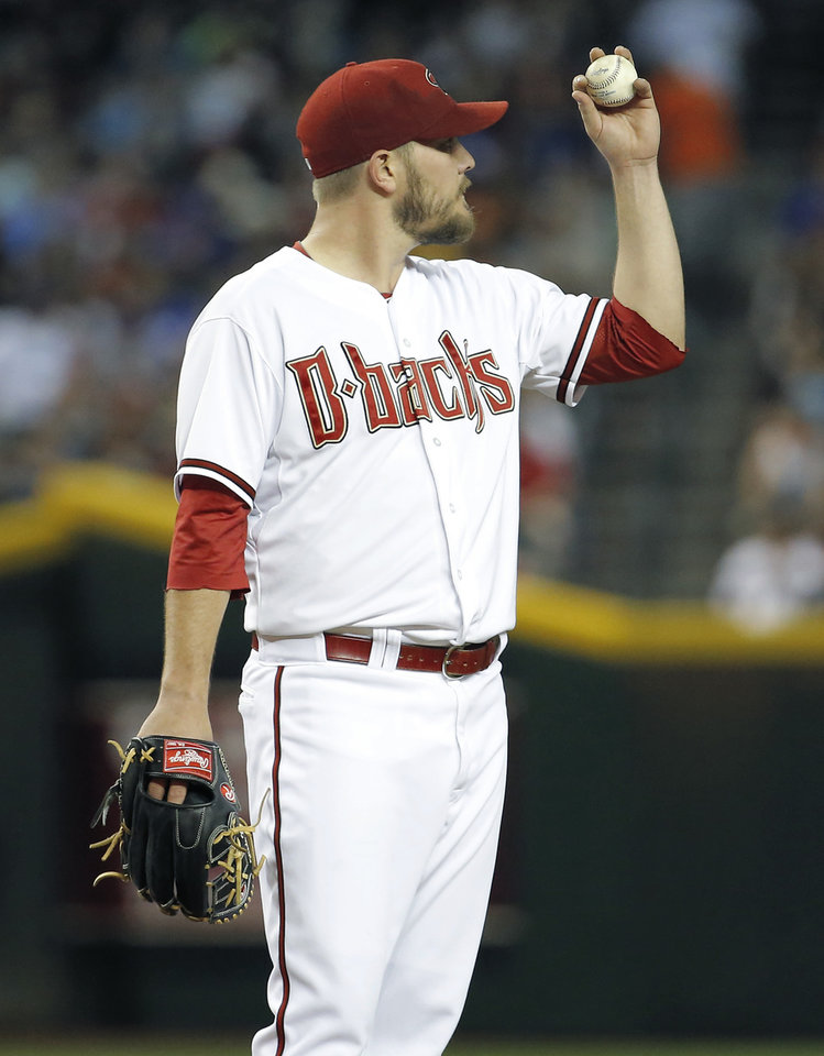 Photo - Arizona Diamondbacks pitcher Wade Miley looks to his outfielders after giving up a run against the Los Angeles Dodgers during the fourth inning of a baseball game on Friday, May 16, 2014, in Phoenix. (AP Photo/Matt York)