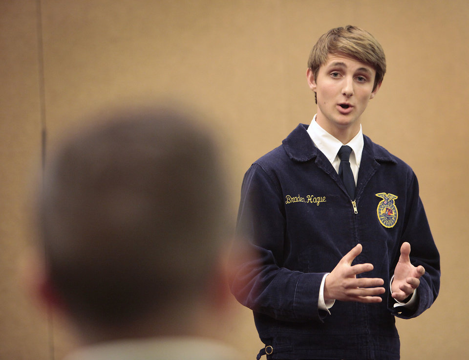 Photo -  Braden Hague, of Edmond, demonstrates his speaking skills during the public speaking competition at the state FFA convention. Photo by David McDaniel, The Oklahoman   David McDaniel -