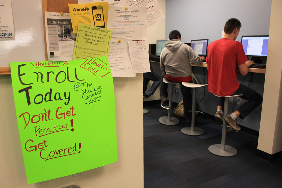 Photo - Students at Central New Mexico Community College apply for taxpayer-subsidized health plans under President Barack Obama's health care law during a special enrollment event in Albuquerque, N.M., Monday, March 31, 2014. (AP Photo/Susan Montoya Bryan)
