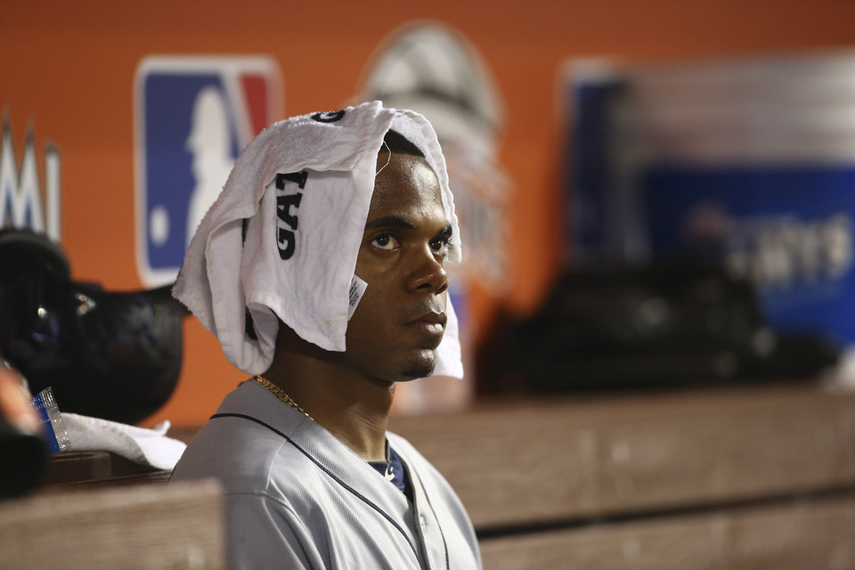 Photo - Seattle Mariners starting pitcher Roenis Elias sits in the dugout during the fifth inning of a baseball game against the Miami Marlins in Miami, Saturday, April 19, 2014. (AP Photo/J Pat Carter)