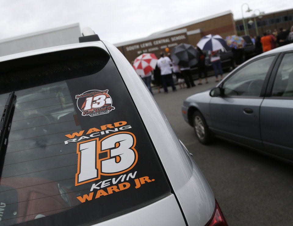 Photo - A Kevin Ward Jr. racing sticker is displayed on a vehicle outside South Lewis Central School after a funeral on Thursday, Aug. 14, 2014, in Turin, N.Y. Ward died after being struck by NASCAR driver Tony Stewart's car during a race last weekend at a dirt track in western New York. (AP Photo/Mike Groll)