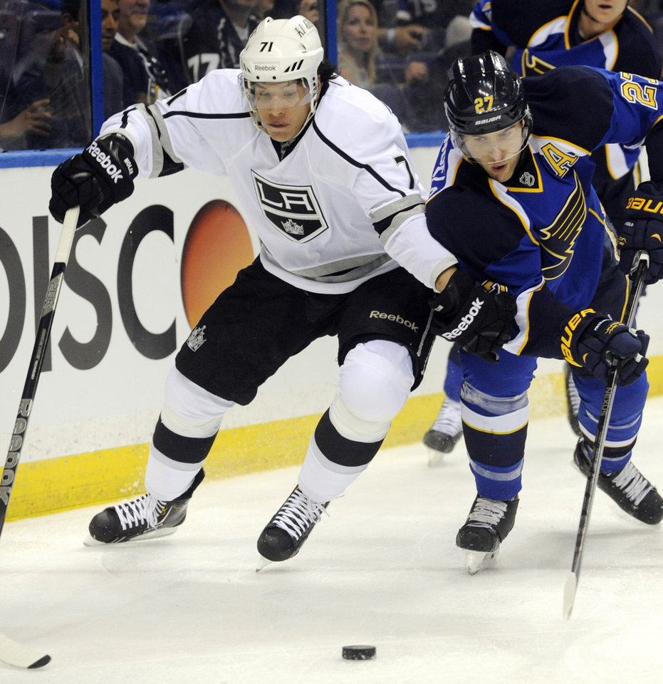 Photo - St. Louis Blues' Alex Pietrangelo (27) and Los Angeles Kings' Jordan Nolan (71) reach for a loose puck during the first period of Game 1 of their first-round NHL hockey Stanley Cup playoff series, Tuesday, April 30, 2013, in St. Louis. (AP Photo/Bill Boyce)