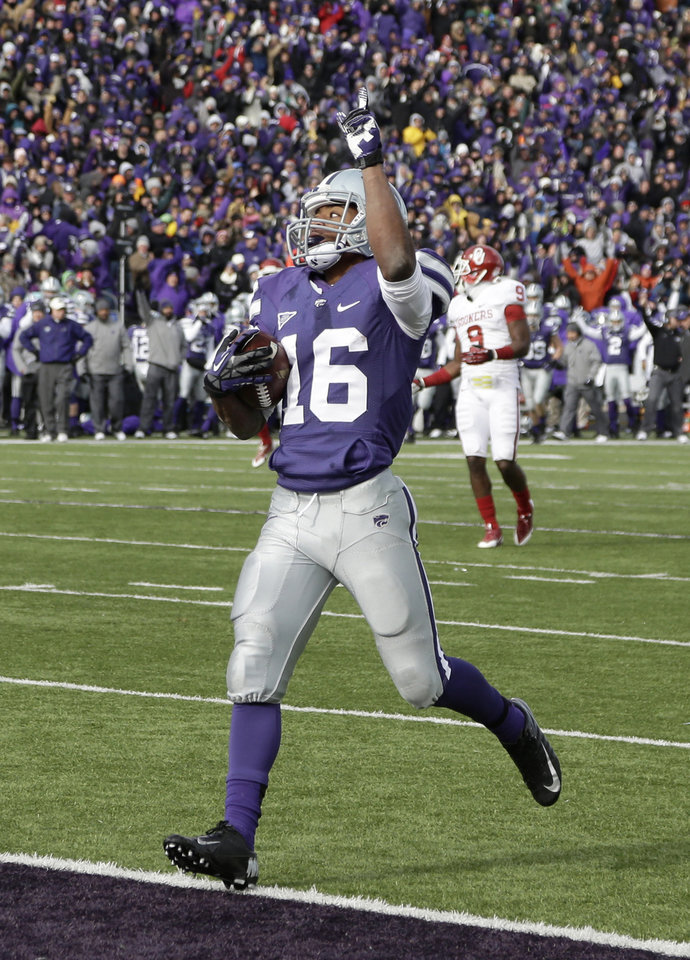 Kansas State wide receiver Tyler Lockett (16) celebrates as he scores a touchdown during the first half of an NCAA college football game against Oklahoma Saturday, Nov. 23, 2013 in Manhattan, Kan. (AP Photo/Charlie Riedel)