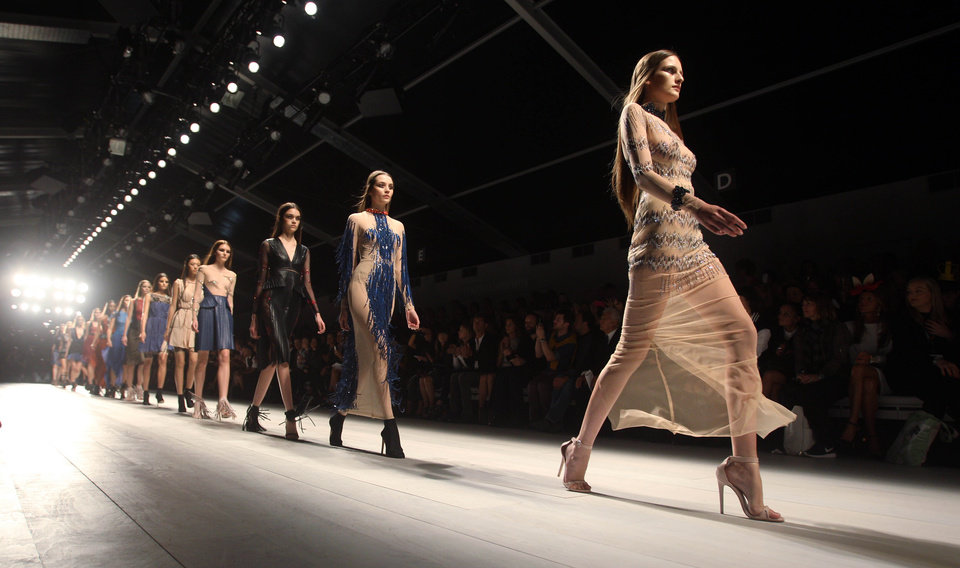 Photo -   Models wear creations from Marios Schwab during London Fashion Week, Sunday, Sept. 16, 2012. (AP Photo/PA, Lewis Whyld) UNITED KINGDOM OUT