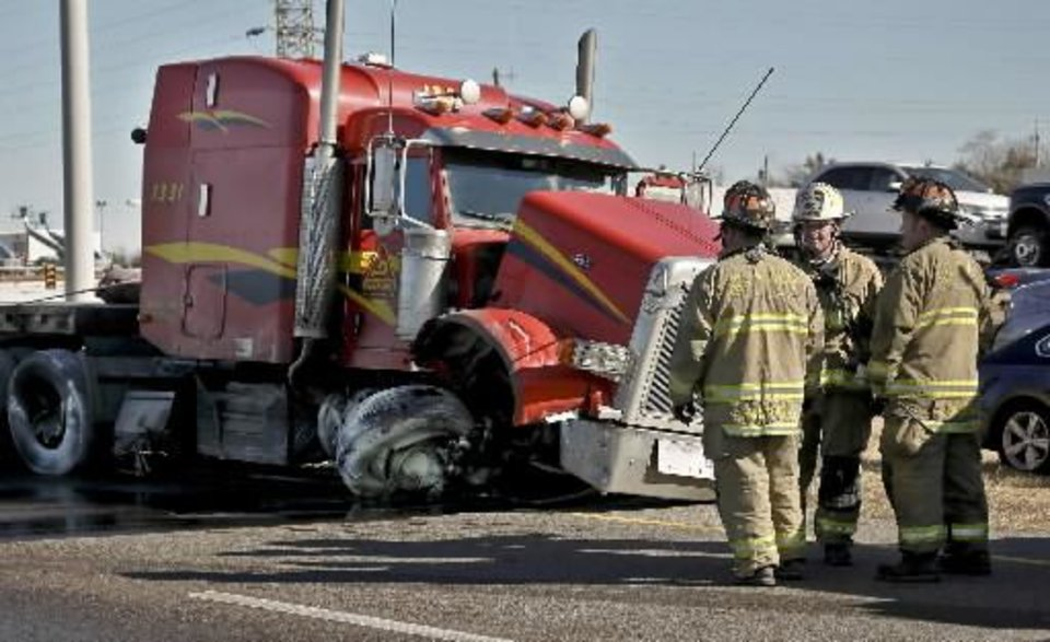 Response crews works the scene of a tractor trailer crash that shut down I-35 southbound at NE 50th due to a diesel spill on Friday, Feb. 1, 2013, in Oklahoma City, Okla. Photo by Chris Landsberger