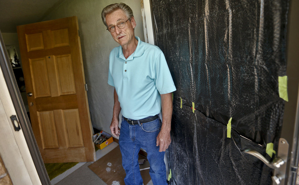 Delton Allen stands in the damaged doorway of his south Oklahoma City home Wednesday. He believes the door was kicked in by a stranded motorist seeking shelter from tornadoes May 31. Allen and his wife were at a neighbor's home at the time.  <strong>CHRIS LANDSBERGER - CHRIS LANDSBERGER</strong>
