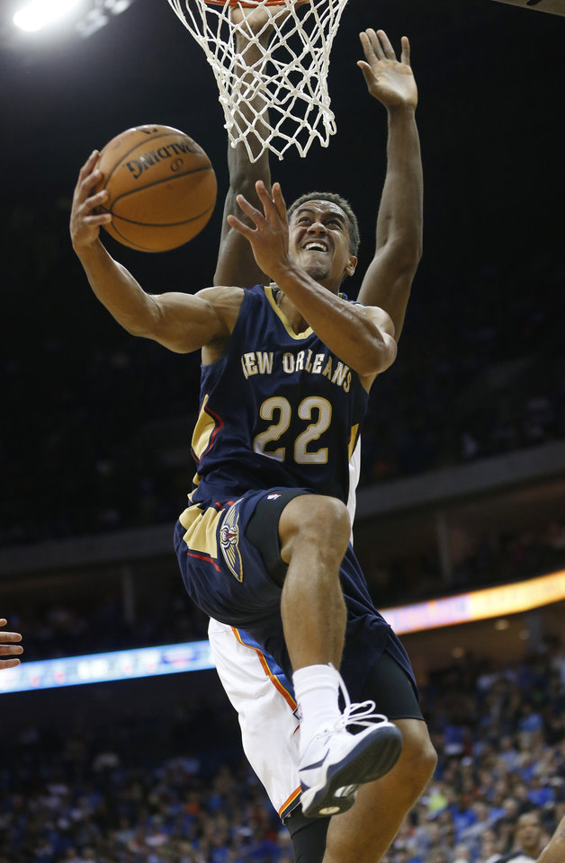 New Orleans Pelicans guard Brian Roberts (22) goes up for a shot in front of Oklhaoma City Thunder forward Serge Ibaka in the second quarter of an NBA basketball preseason game in Tulsa, Okla., Thursday, Oct. 17, 2013. (AP Photo/Sue Ogrocki) ORG XMIT: OKSO109