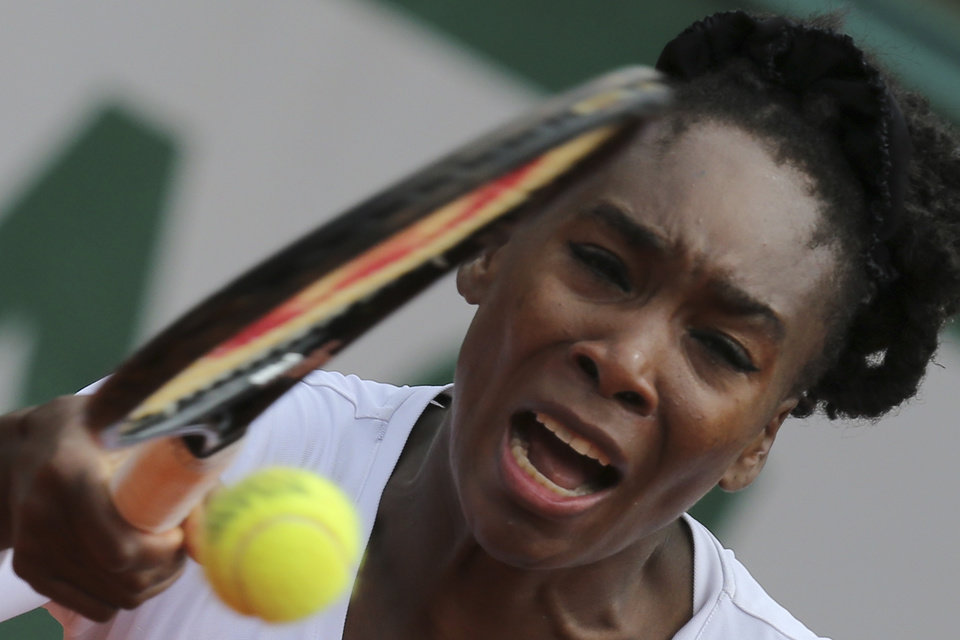 Photo - Venus Williams of the U.S. returns the ball during the second round match of the French Open tennis tournament against Slovakia's Anna Schmiedlova at the Roland Garros stadium, in Paris, France, Wednesday, May 28, 2014. (AP Photo/David Vincent)