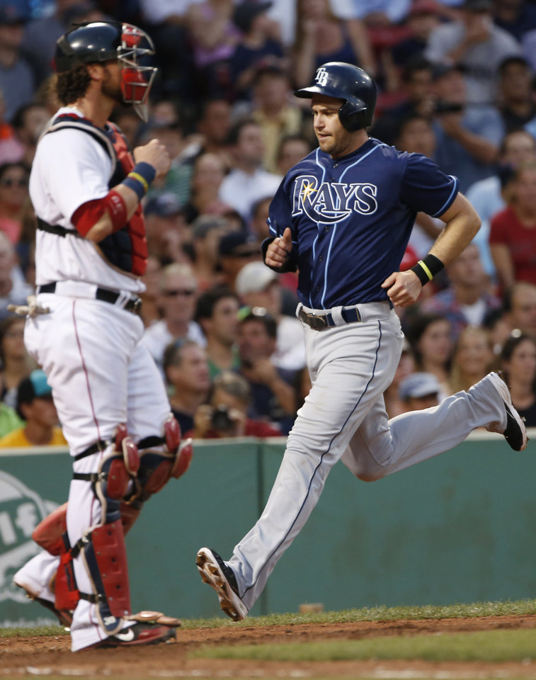 Photo - Tampa Bay Rays' Evan Longoria runs home to score next to Boston Red Sox catcher Jarrod Saltalamacchia, on a single by Wil Myers during the third inning of a baseball game at Fenway Park in Boston on Wednesday, July 24, 2013. (AP Photo/Elise Amendola)