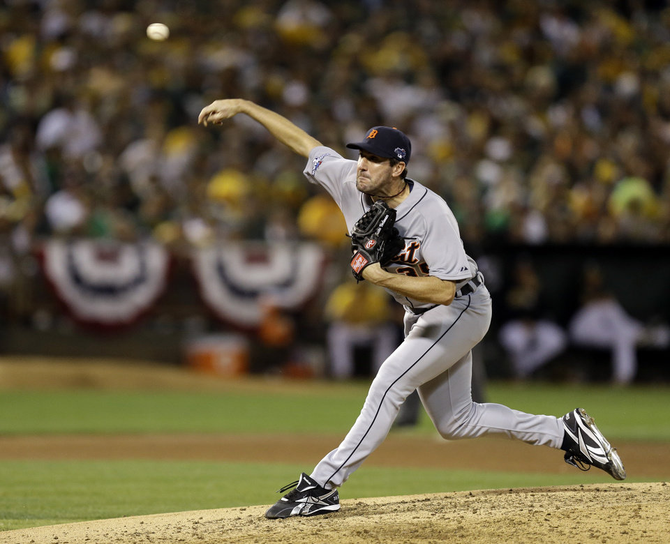 Detroit Tigers pitcher Justin Verlander throws a pitch in the fourth inning of Game 2 of an American League baseball division series against the Oakland Athletics in Oakland, Calif., Saturday, Oct. 5, 2013. (AP Photo/Ben Margot)