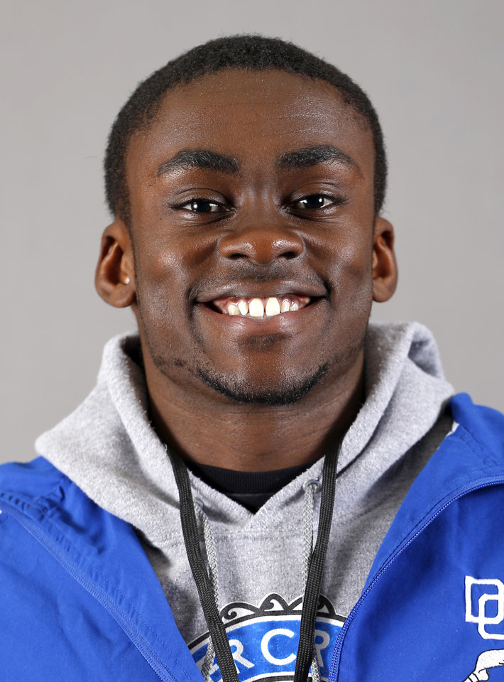 Photo - Otugo Ananaba with the Deer Creek boys track team poses for a mug during the spring high school sports photo day in Oklahoma City, Wed. Feb. 27, 2013. Photo by Bryan Terry, The Oklahoman