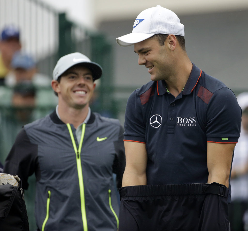 Photo - Martin Kaymer, of Germany, right, and Rory McIlroy, of Northern Ireland, arrive on the 10th hole during the second round of the PGA Championship golf tournament at Valhalla Golf Club on Friday, Aug. 8, 2014, in Louisville, Ky. (AP Photo/David J. Phillip)
