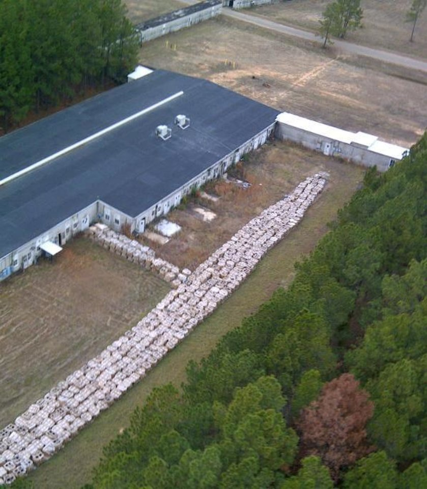 FILE - This undated file aerial photo provided by the Louisiana State Police via The Shreveport Times shows part of the smokeless explosive powder improperly stored outside Explo Systems Inc., a munitions dismantling facility at Camp Minden at Doyline, La. Explo Systems is currently under investigation for improperly storing millions of pounds of a military propellant, prompting the evacuation of the nearby town of Doyline. Documents reviewed by The Associated Press show Explo Systems Inc. was previously cited for safety violations in 2007 after old Army explosives were used in mining operations in West Virginia. (AP Photo/Louisiana State Police via The Shreveport Times)