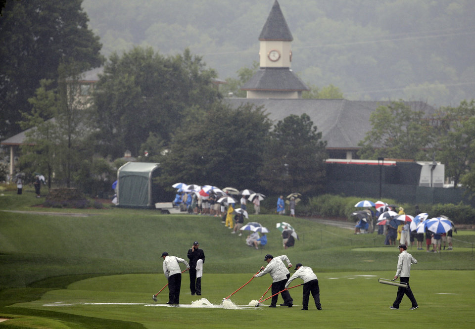 Photo - Members of the grounds crew push water off the 10th fairway during the second round of the PGA Championship golf tournament at Valhalla Golf Club on Friday, Aug. 8, 2014, in Louisville, Ky. (AP Photo/David J. Phillip)